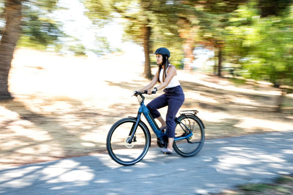 Woman on bicycle | Ultimate C380